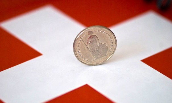 Swiss-franc-on-Swiss-flag
